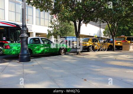 Newark, New Jersey - August 15th 2019: A queue of taxis line up along the busy, tree-lined, Market Street, just outside Penn Station, in Newark NJ. - Stock Photo