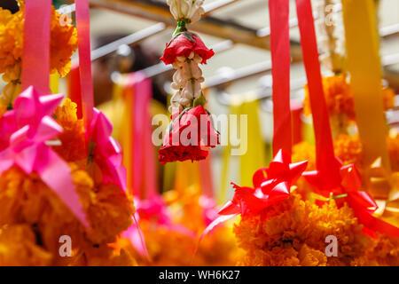 Phuang malai, traditional Thai flower offerings at Wat Mangkon Kamalawat or Wat Leng Noei Yi, largest Chinese Buddhist temple in Bangkok, Thailand - Stock Photo
