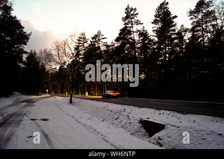 Snowy Road Passing Through Forest - Stock Photo