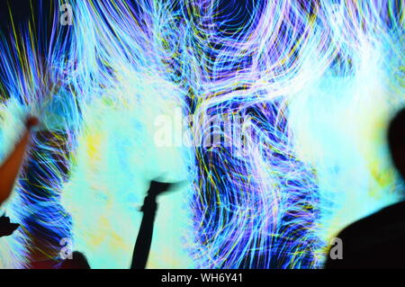 KOSINO, RUSSIA - JULY 18, 2015:  Abstract light stripes on the screen - Stock Photo