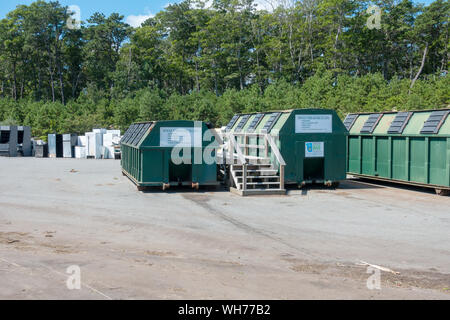 Single Stream recycling center containers & old refrigerators & appliances beyond at US landfill Bourne Integrated Solid Waste Management facility - Stock Photo