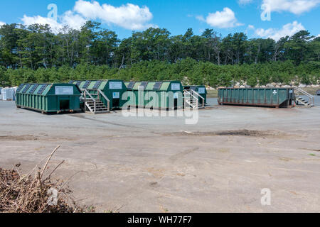 Single Stream recycling center containers for glass, plastic and paper at US landfill at the Bourne Integrated Solid Waste Management facility - Stock Photo