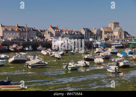 BARFLEUR, FRANCE - JULY 3: Fishing and recreational boats at low tide in the harbor of Barfleur, France on July 3, 2011. Barfleur is a picturesque fis - Stock Photo