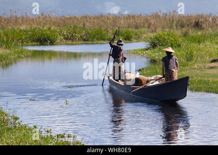 Local People In Boat On Inle Lake - Stock Photo