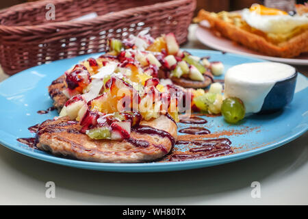 High Angle View Of Pancakes With Fruits Served In Plate On Table - Stock Photo