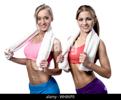 Two beautiful girls after workout with towels isolated on white background - Stock Photo