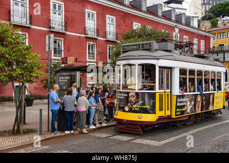 Lisbon, Portugal - July 27, 2019: Trams providing mass public transportation in the Alfama district of Lisbon, Portugal - Stock Photo