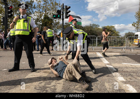 Excel Centre, London, UK. 2nd Sep, 2019. Protesters attempt to stop an HGV lorry entering the arms fair at Excel Centre. Credit: Penelope Barritt/Alamy Live News - Stock Photo