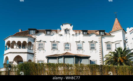 Cascais, Portugal - August 30, 2019: Facade of whitewashed historic villa in the historic centre of Cascais, Portugal