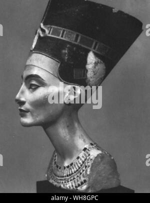 Bust of Queen Nefertiti. Nefertiti was the wife of the Egyptian Pharaoh Amenhotep IV (later Akhenaten), and mother-in-law of the Pharaoh Tutankhamen. Her name roughly translates to the beautiful one is come. The bust is one of the most copied works of ancient Egypt. It was attributed to the sculptor Djhutmose, and was found in his workshop. The Treasures of Tutankhamen. Tutankhamen by Christiane Desroches Noblecourt, page 105.. - Stock Photo