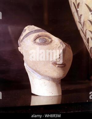 A goddess in her sacred cave?  Pottery head from Psychro - probably the Diktean cave - Stock Photo
