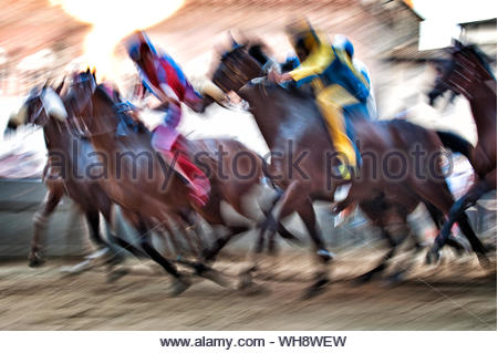 Panning photography during La Mossa (The start), Piazza del Campo, Siena Palio, Siena, Tuscany, Italy, Europe - Stock Photo