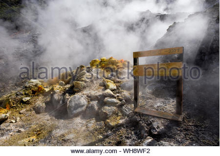 Hot steam and sulfurous fumes rise from fumarole, Solfatara volcano, Pozzuoli, Campi Flegrei (Phlegraean Fields), Campania, Italy, Europe - Stock Photo