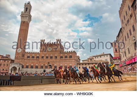 La Mossa (The start), Piazza del Campo with Palazzo Comunale and Torre del Mangia, UNESCO World Heritage Site, Siena Palio, Siena, Tuscany, Italy - Stock Photo