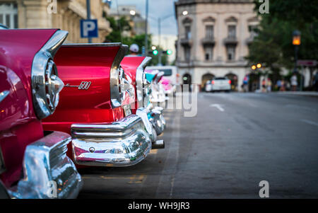 Colourful old American taxi cars parked in Havana at dusk, UNESCO World Heritage Site, La Habana, Cuba, West Indies, Caribbean, Central America - Stock Photo