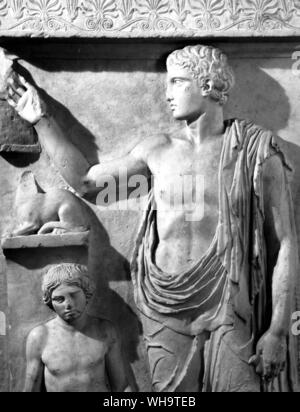 Youth who holds a bird in his left hand and raises his right to a cage.  From a gravestone, c.400 BC - Stock Photo