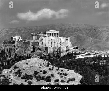 The Acropolis, a great rock to the south of Athens, bears remains of temples and walls from pre-Greek and sixth-century days.  Cimon built the great w - Stock Photo