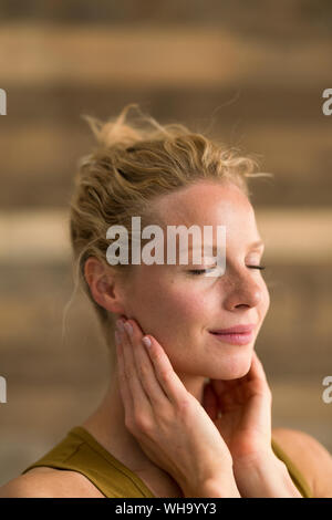 Portrait of beautiful blond woman, wooden background Stock Photo