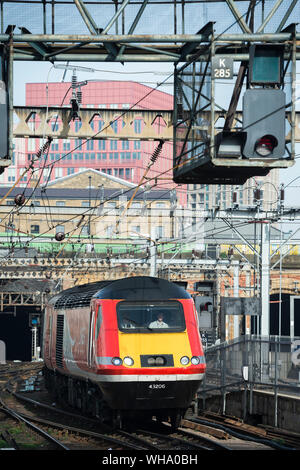 High speed train in LNER livery leaving King's Cross Railway Station, London, England. - Stock Photo