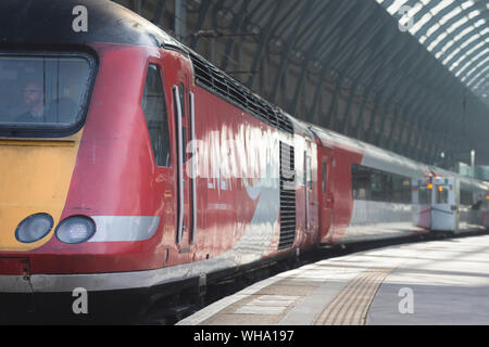 HIgh speed train in LNER livery waiting at King's Cross Railway Station, London, England. - Stock Photo