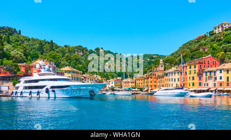 Panoramic view of small port with yachts and boats in Portofino town, Liguria, Italy - Stock Photo