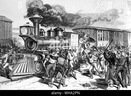 West Virginia - The Baltimore and Ohio railroad strike - the disaffected workmen dragging firemen and engineers from a Baltimore freight train at Martinsburg, July 17th - A violent incident on the tracks - c.1870. - Stock Photo
