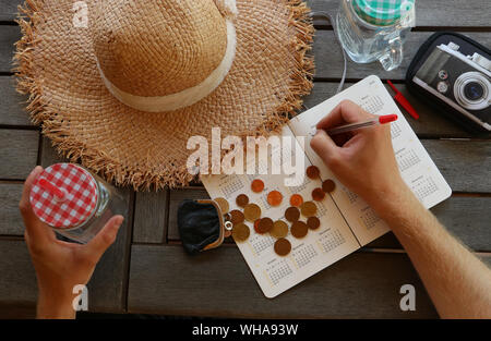 Cropped Hand Writing In Calculator At Home - Stock Photo
