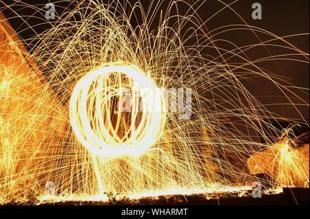 Burning Steel Wool At Night - Stock Photo