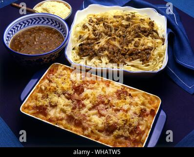 Italian Cooking By Robin Howe. . Top.. Tagliatelle alla Bolognese.. Noodles With Bolognese Sauce.. . Bottom.. Timballo Di Maccheroni.. Macaroni And Bacon Casserole.. - Stock Photo