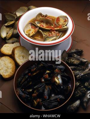 Italian Cooking By Robin Howe. . Top.. Zuppa Di Arselle Or Vongole.. Clam Soup.. . Bottom.. Zuppa Di Cozze. Mussel Soup. - Stock Photo