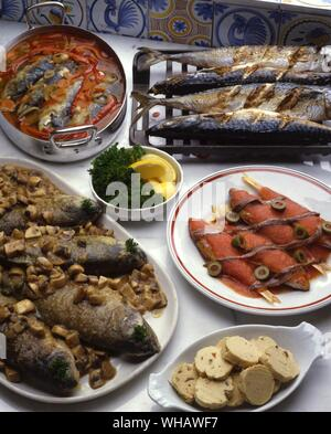 French Recipes . . Clockwise From Top Left.. Sardines A L'Escabeche.. Marinated Sardines.. . Marquereau A La Diable.. Devilled Mackerel.. . Rougets A La Nicoise.. Red Mullet.. . Truites A La Grenobloise.. Grenoble Trout. - Stock Photo