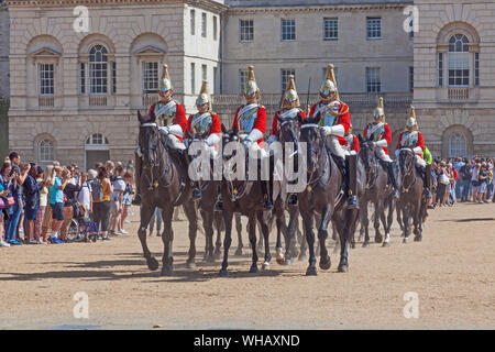 London, Westminster. A troop of Royal Life Guards leaving Horse Guards Parade following the Changing of the Guard ceremony. - Stock Photo