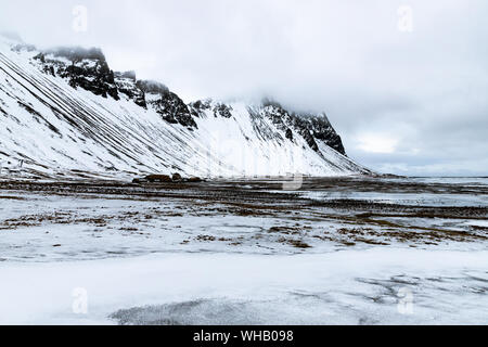 Stokksnes peninsula with Vestrahorn mountains in the background - Stock Photo