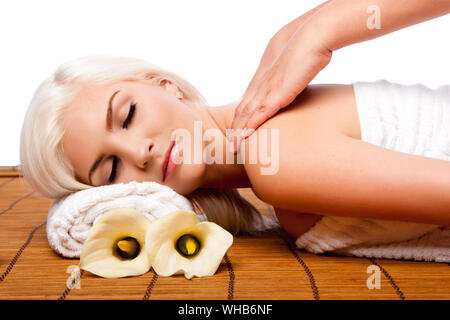 Young Woman Receiving Back Massage Against White Background - Stock Photo