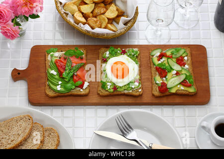 avocado toast open sandwich variety isolated on white background - Stock Photo