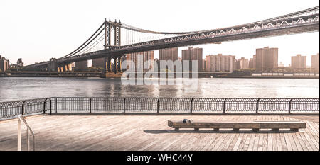 Panoramic View Of Manhattan Bridge Over East River - Stock Photo