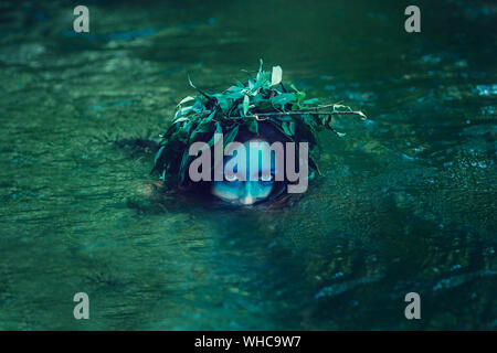 Young drown woman in a poetic representation.  The concept of the undead dark tales and legends - Stock Photo