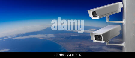 Surveillance CCTV Cameras. Security cam outdoors against earth curvature background, banner, copy space. 3d illustration - Stock Photo
