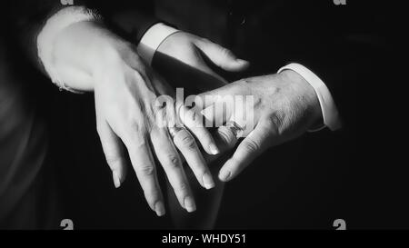 Cropped Hands Of Couple Showing Wedding Rings - Stock Photo