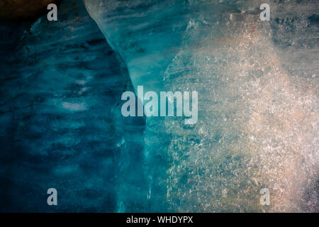blue ice inside a cave under melting rhone glacier, switzerland - Stock Photo