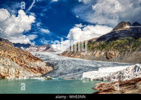 panorama of melting rhone glacier in swiss alps, switzerland - Stock Photo