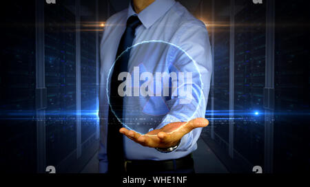 Man with dynamic nuclear energy symbol hologram on hand. Businessman and futuristic concept of science, danger icon and warning with light and glitch - Stock Photo