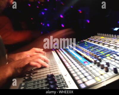 Dj Using Mixing Desk At Club - Stock Photo
