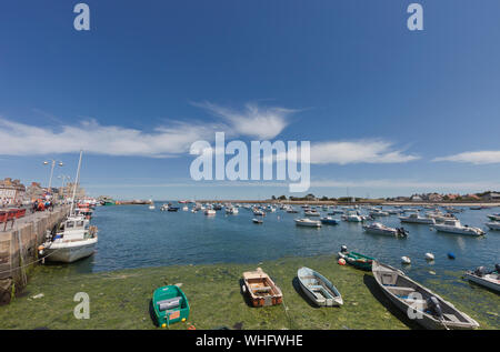 BARFLEUR, FRANCE - JULY 4: Fishing and recreational boats at low tide in the harbor of Barfleur, France on July 4, 2011. Barfleur is a picturesque fis - Stock Photo