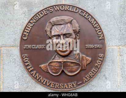 Bronze plaque in memory of Formula One motor racing World Champion Jim Clark in the Berwickshire village of Chirnside. - Stock Photo
