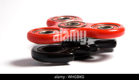 Close-up Of Fidget Spinners On White Background - Stock Photo