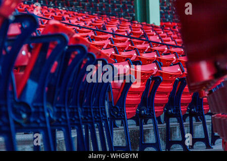 Rear View Of Red Chairs In Rows - Stock Photo