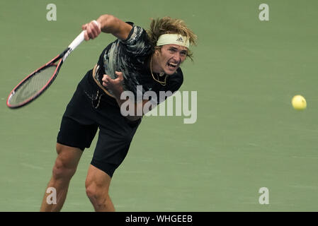 New York, USA. 02nd Sep, 2019. Alexander Zverev, of Germany, serves to Diego Schwartzman, of Argentina, in the 4th round in Arthur Ashe Stadium at the 2019 US Open Tennis Championships at the USTA Billie Jean King National Tennis Center on Monday September 2, 2019 in New York City.     Photo by Ray Stubblebine/UPI Credit: UPI/Alamy Live News - Stock Photo