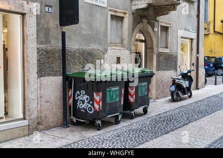 Verona, Italy - July 27, 2019:  TCity waste bins on the side of the street in Verona Italy - Stock Photo