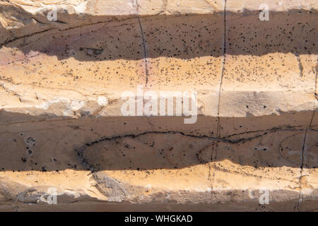 Cracked antique light red marble indented  texture and background.  Rough natural rock texture. - Stock Photo